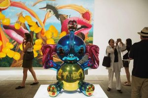 Attendees walk past the sculpture Elephant and the painting Lips during a press preview before the opening of a Jeff Koons retrospective at the Whitney Museum of American Art in New York June 24, 2014.  REUTERS/Lucas Jackson (UNITED STATES - Tags: SOCIETY)
