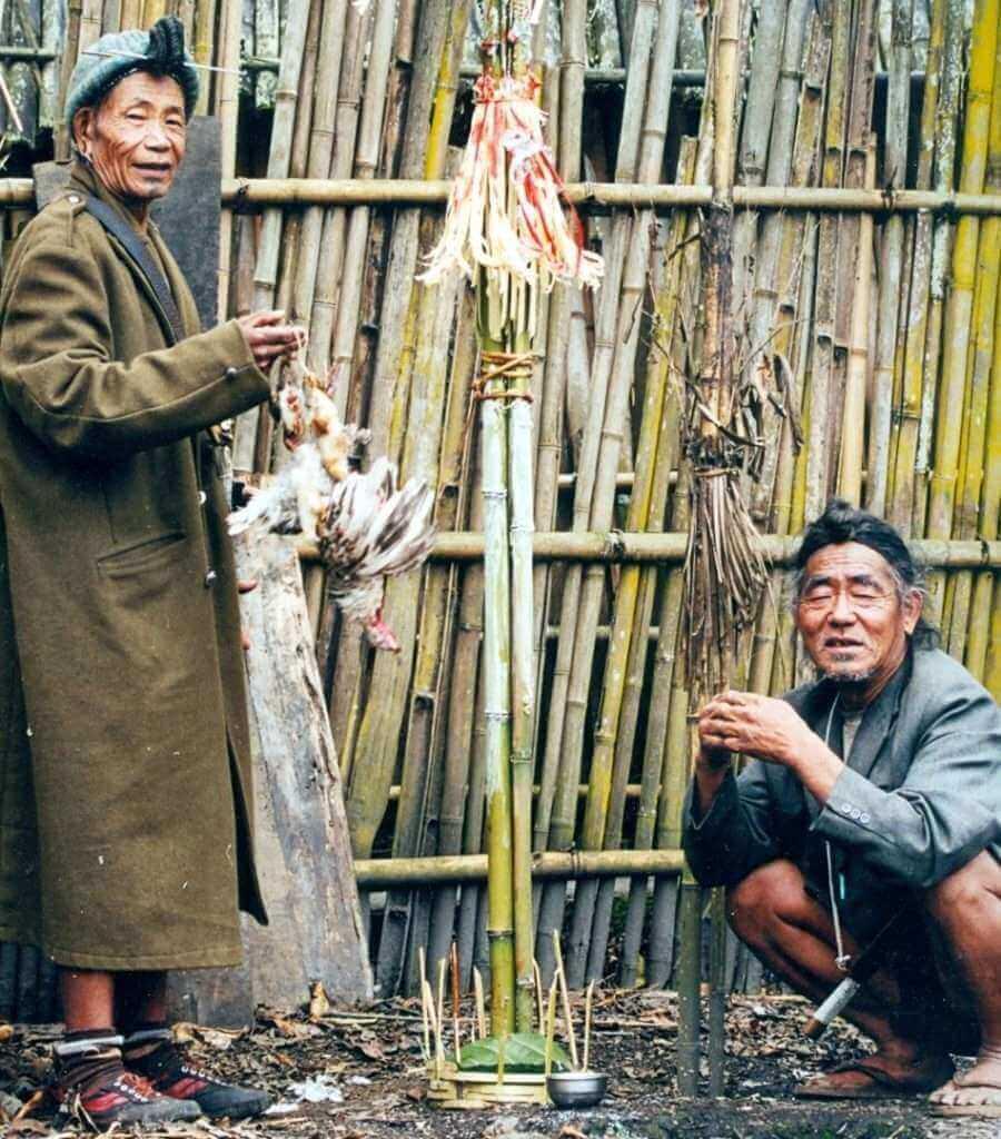 Apa Tani Nyibus conducting a chicken liver divination , Reru Village, Arunachal Pradesh, 2000 (Large)